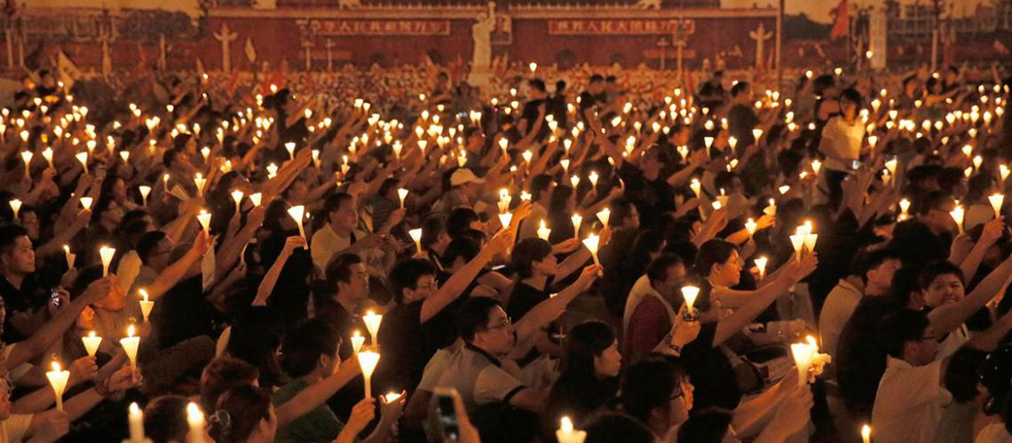 Participants hold candles at Tiananmen Square protest vigil, June 2016 in Hong Kong